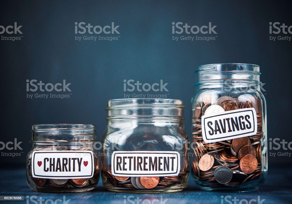 Three Money Jars Filled With American Currency Savings And Donation Concepts Stock Photo Download Image Now Istock