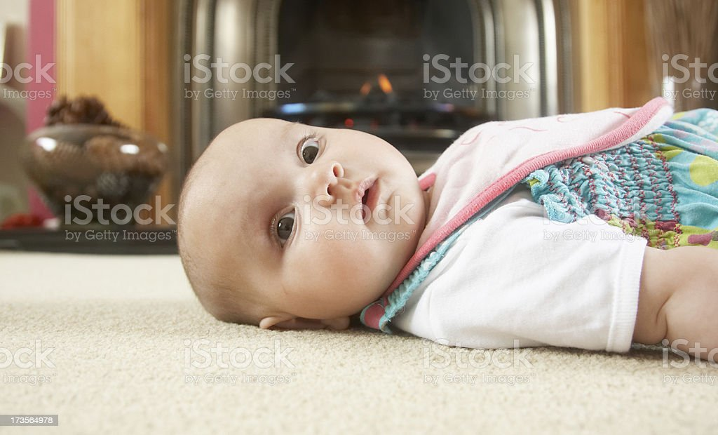 Three month old girl on carpet royalty-free stock photo