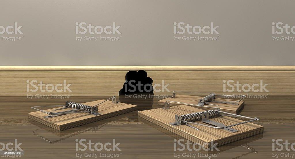 Three Mousetraps Outside A Hole stock photo