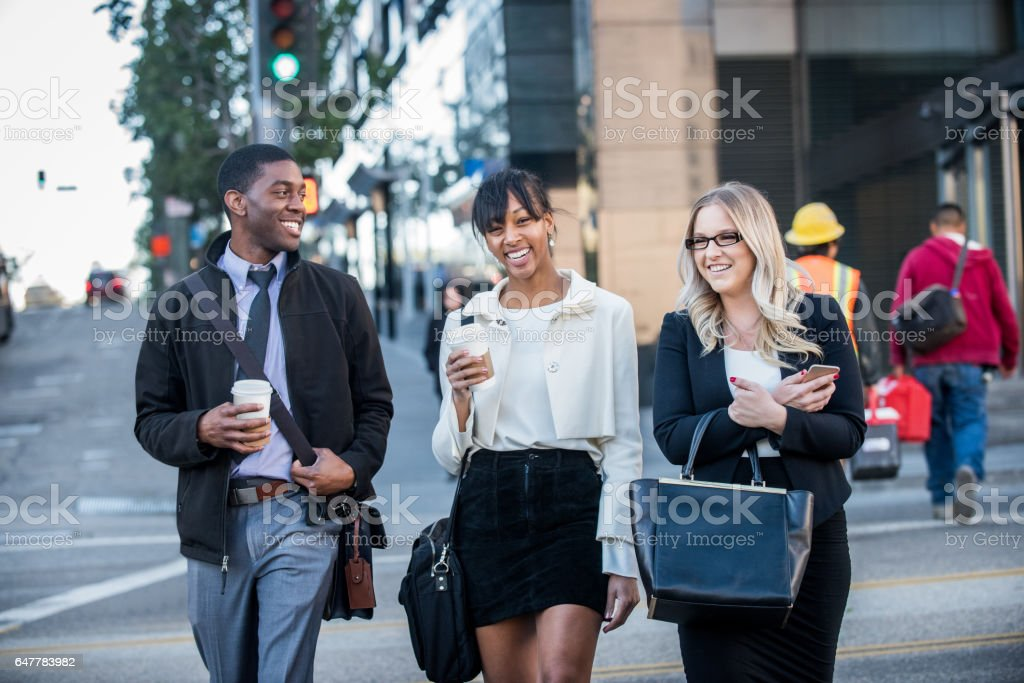 Three Multi Ethnic Millennials in business attire with coffee in Downtown Los Angeles stock photo