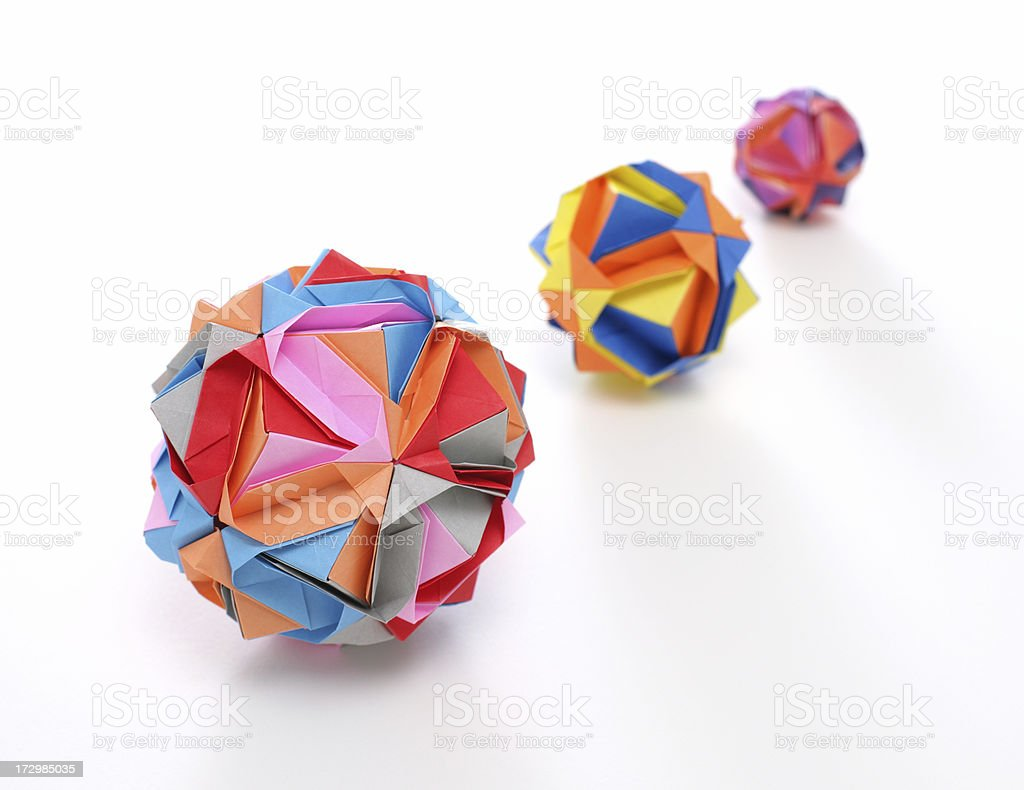 Three multicolored geometric origami polyhedron paper craft royalty-free stock photo