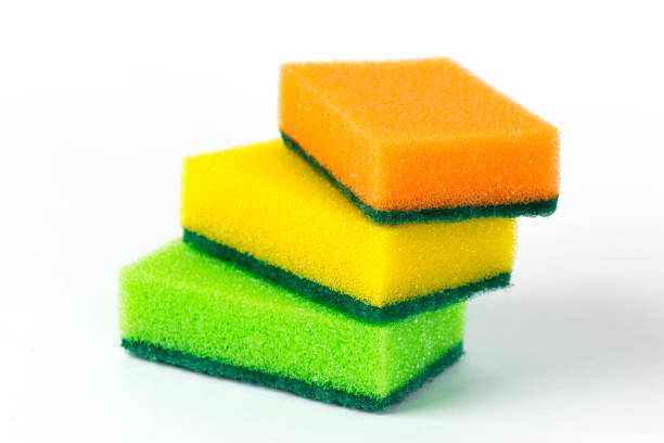 three multi-colored sponges for washing dishes isolated on white background - spugna per le pulizie foto e immagini stock