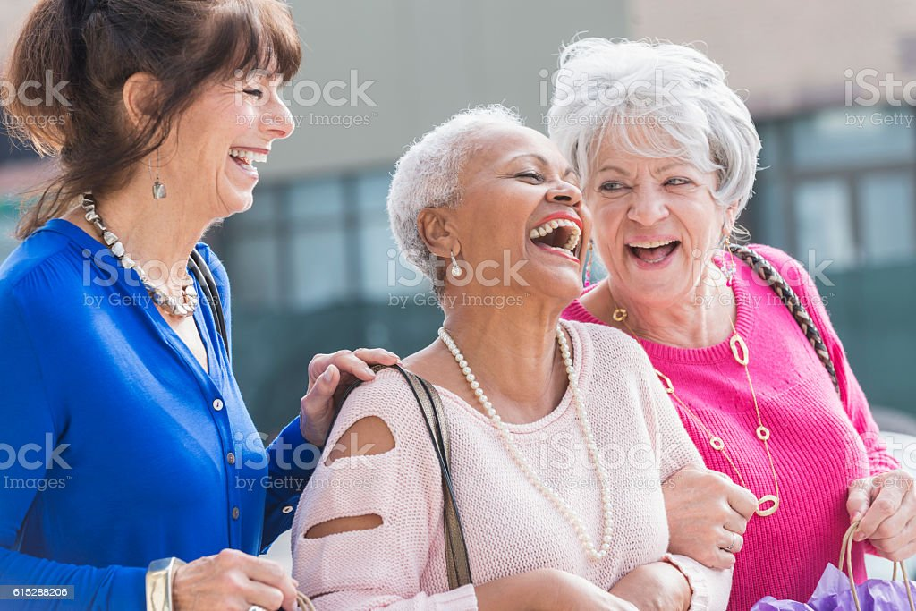 Three multi-ethnic senior women out shopping - foto de acervo