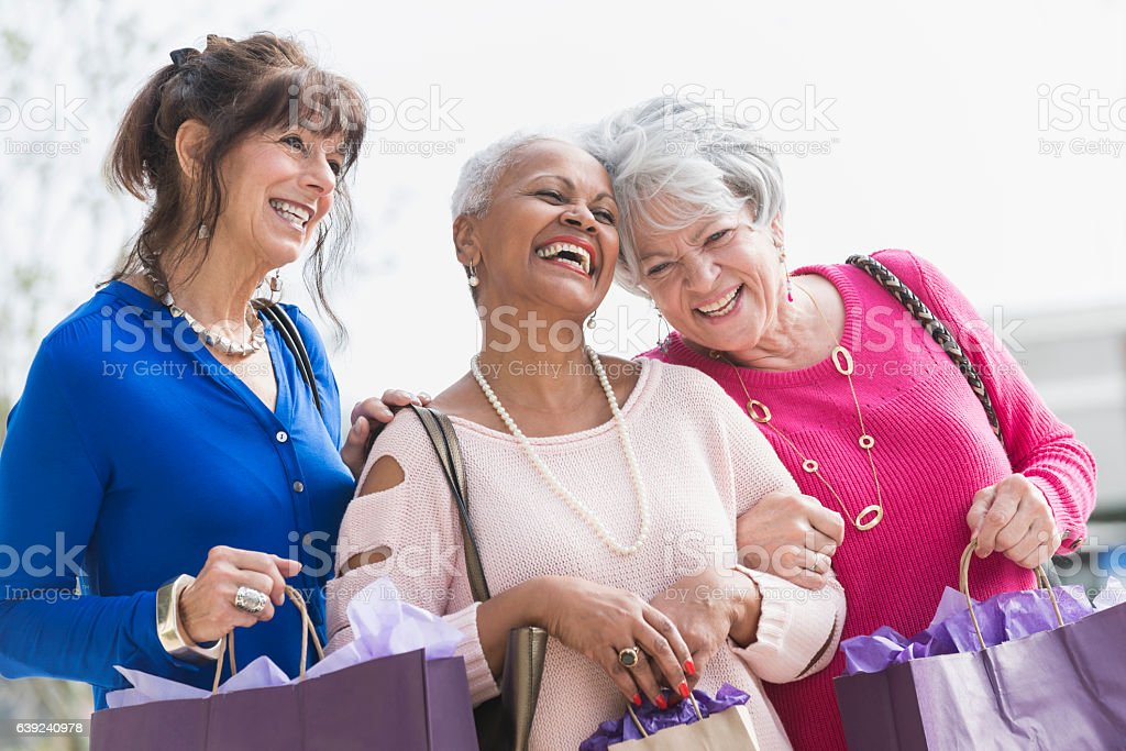 Three multi-ethnic senior women out shopping​​​ foto