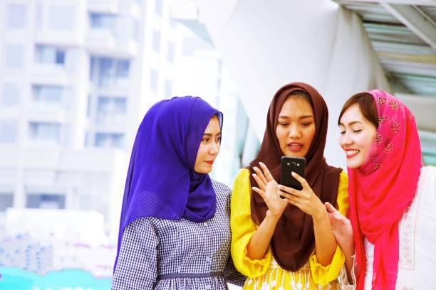 Three Muslim ladies are spending time in the city. stock photo