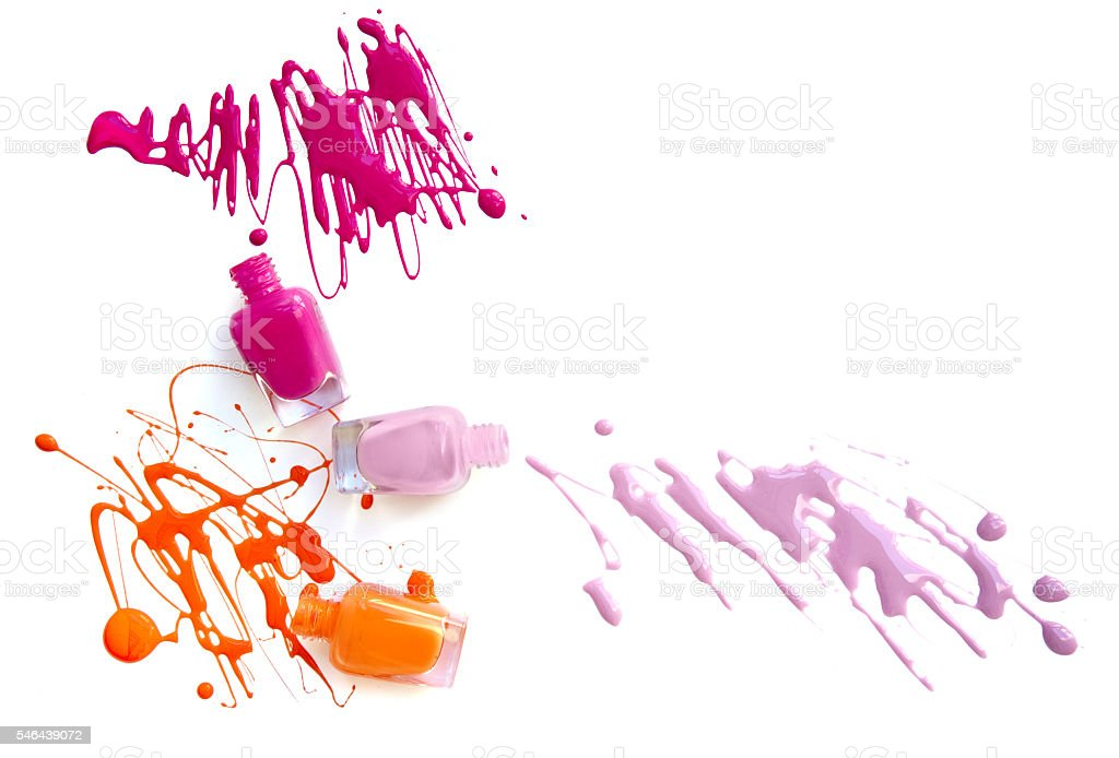 Three nail polish bottles with splash stock photo