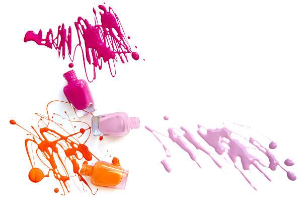 three nail polish bottles with splash - enamel stock photos and pictures