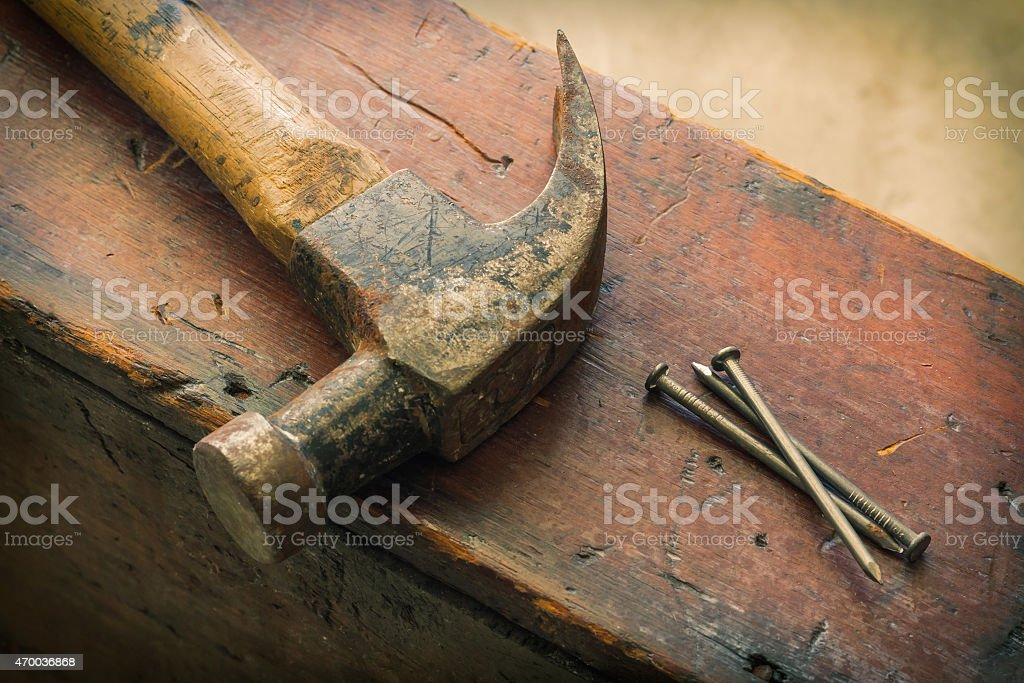 Three Nails and Hammer stock photo