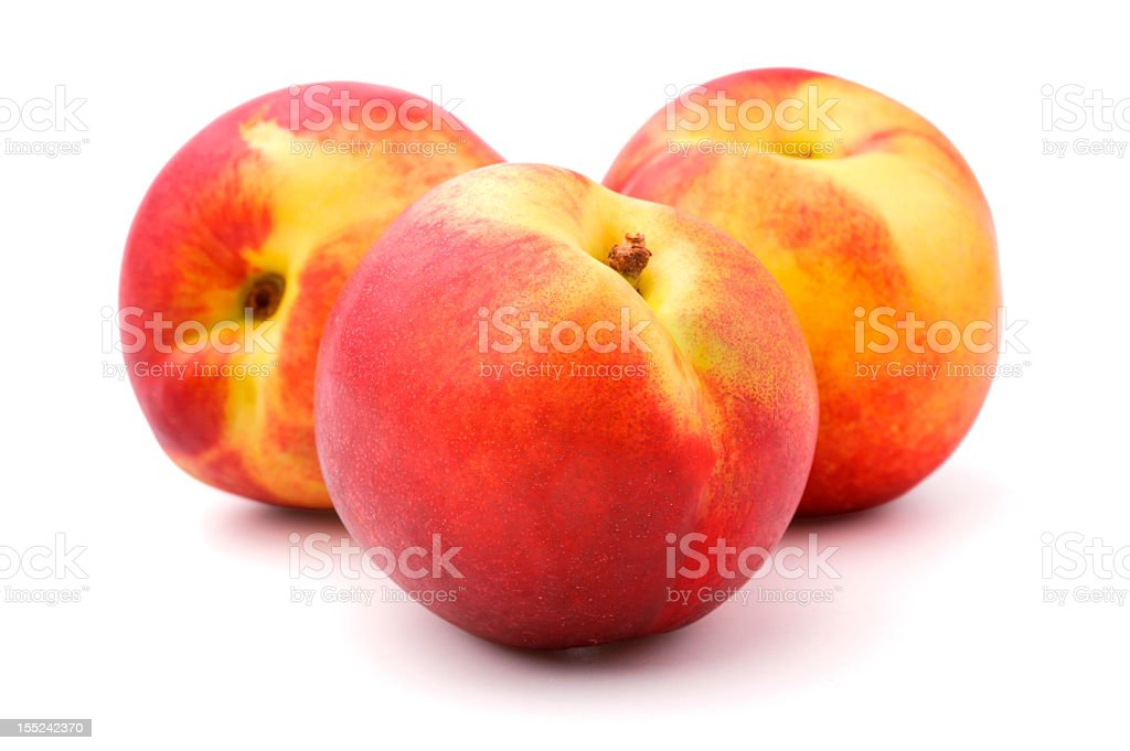 Three nectarines, isolated, white background stock photo