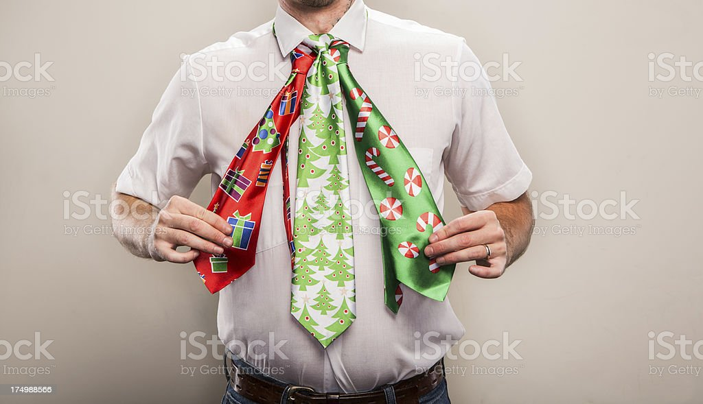 Three Nerdy Christmas Neckties on an Office Man for Holidays stock photo