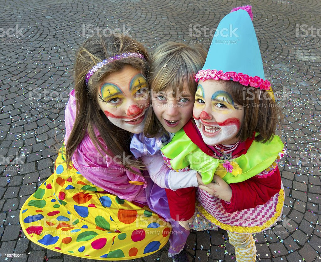 Three nice italian children with dresses and makeup for carnival royalty-free stock photo