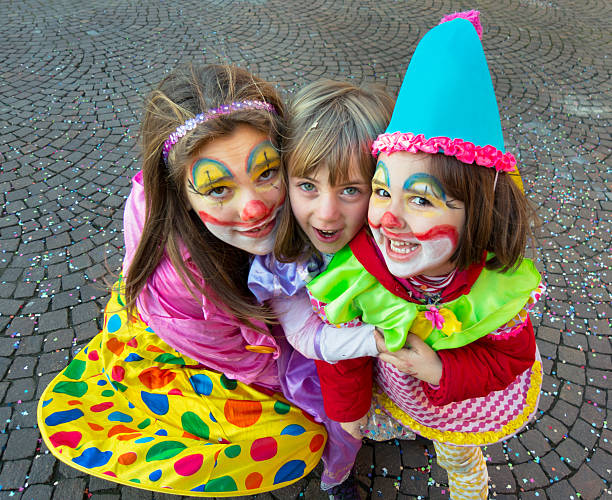 Three nice italian children with dresses and makeup for carnival stock photo