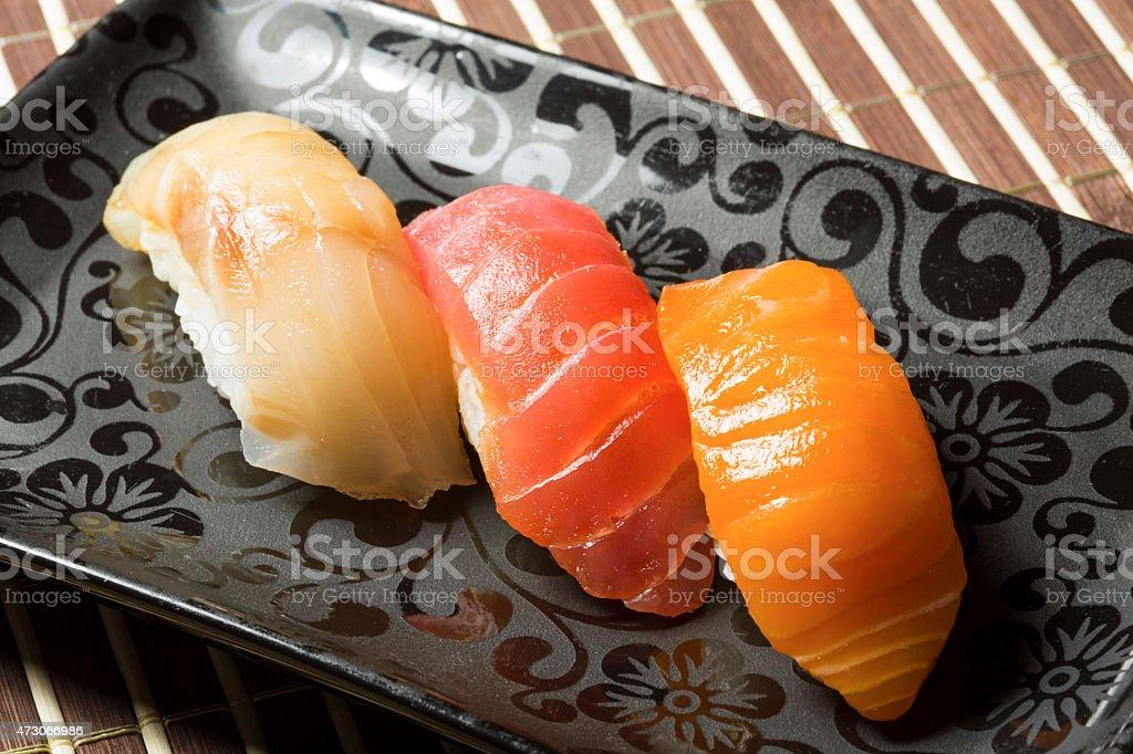 Three nigiri sushi assortment - hamachi, maguro, sake stock photo
