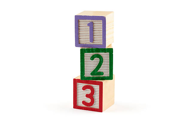 three numbered building blocks on white background - toy stock pictures, royalty-free photos & images