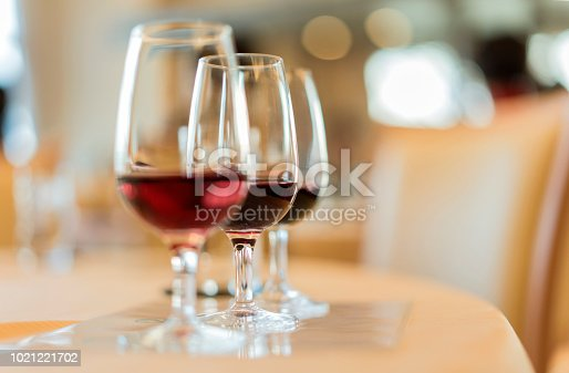 Oenology tasting of great vintage red wine vintages on a yellow table cloth and a bokeh background.