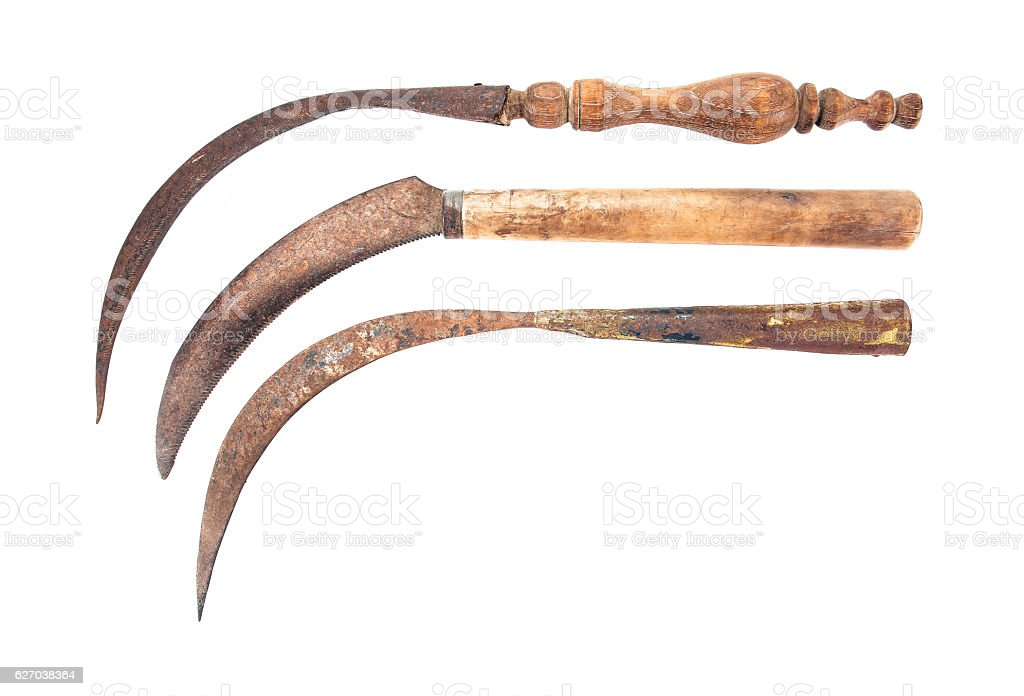 Three of old rusty sickle isolated on white background.Old sickle stock photo