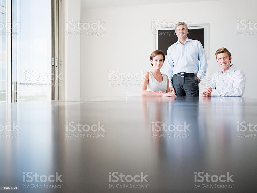 Three office workers in a conference room royalty-free stock photo