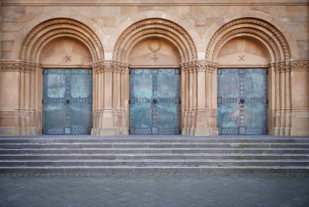 Three old church doors stock photo