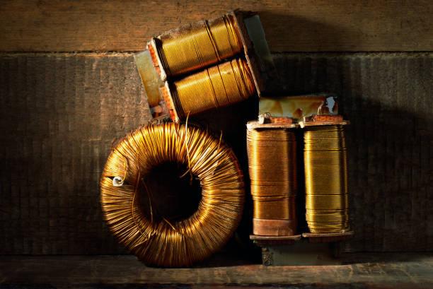 Three old copper wire coils. stock photo