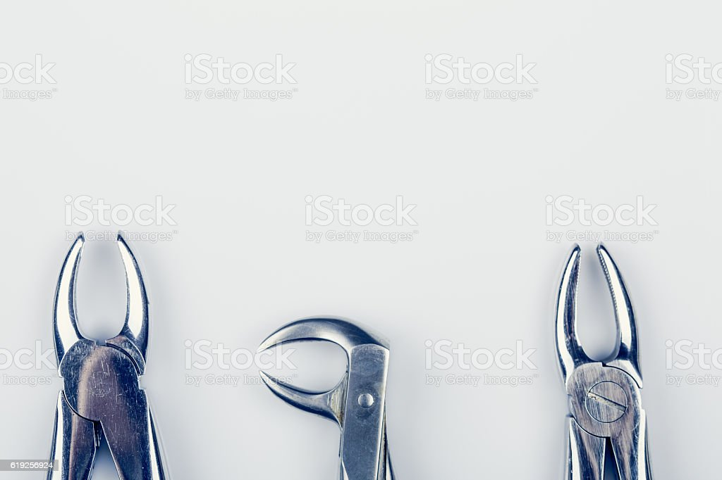 three old dental pincers - removers stock photo