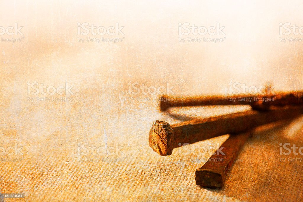 Three old iron nails on linen background stock photo