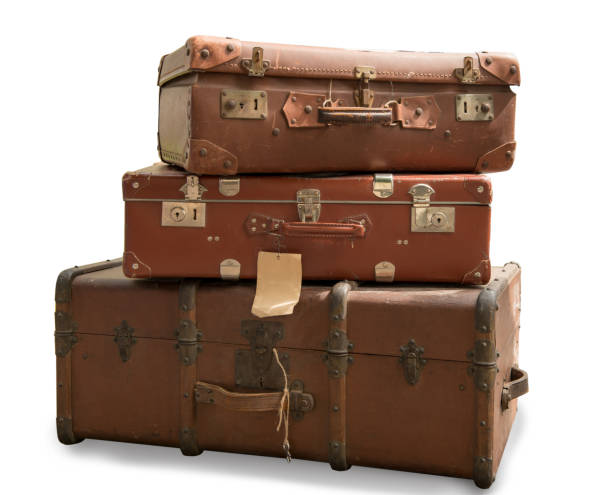 three old suitcases isolated on a white background stock photo