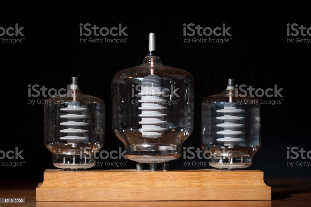 Three old vacuum transmitting tubes stock photo