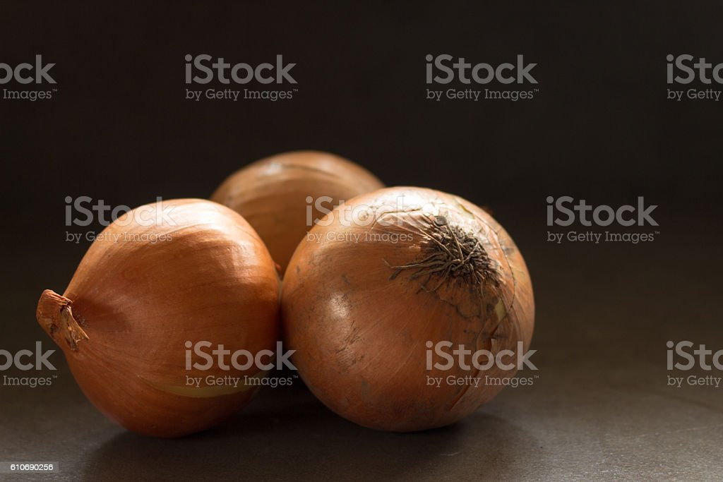 Three Onions on Counter Top stock photo