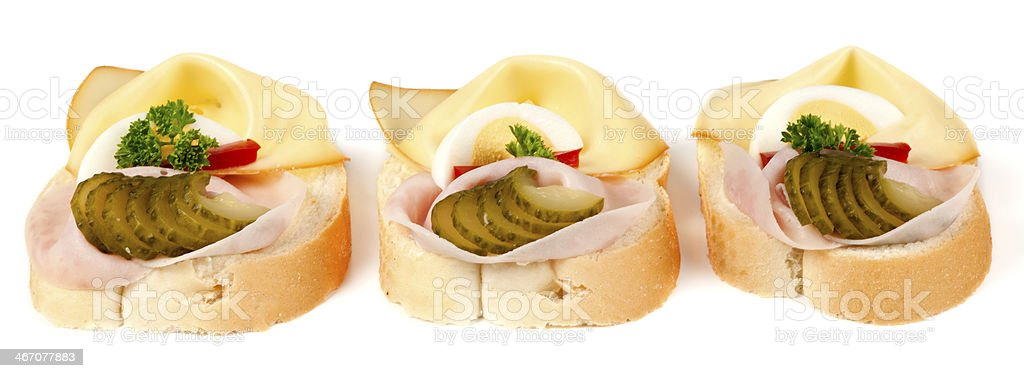 Three open sandwiches with ham and cheese royalty-free stock photo