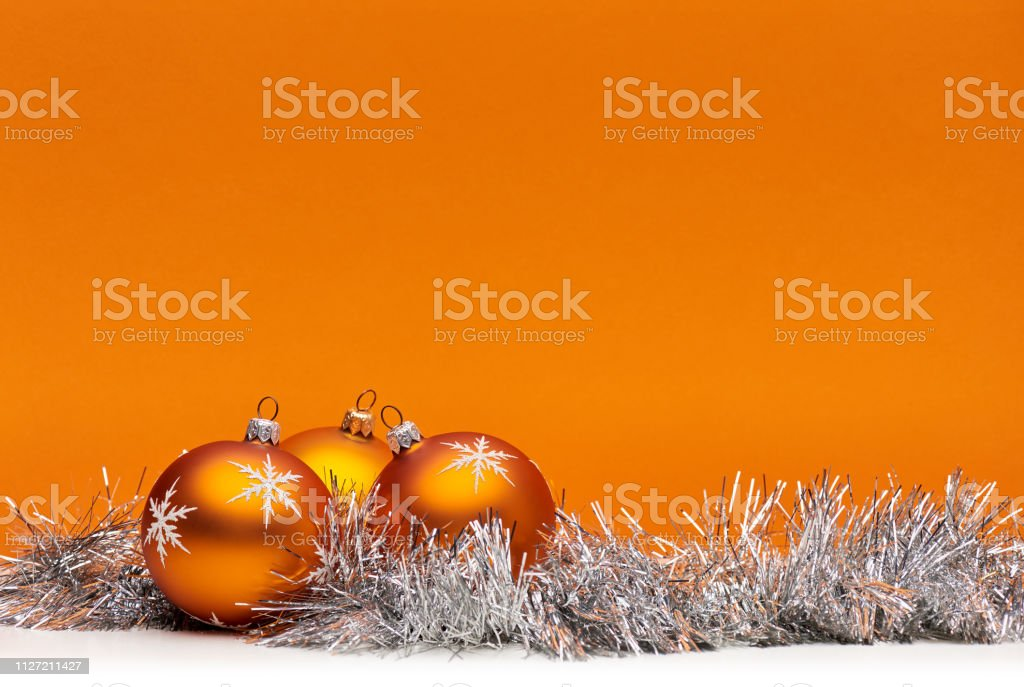 Three Orange Bauble Christmas Decorations Against An Orange Background With Space For Copy Text Stock Photo Download Image Now Istock
