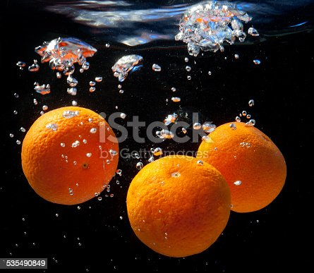 1169153675 istock photo three oranges in water 535490849