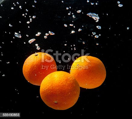 1169153675 istock photo three oranges in water with bubbles 535490853