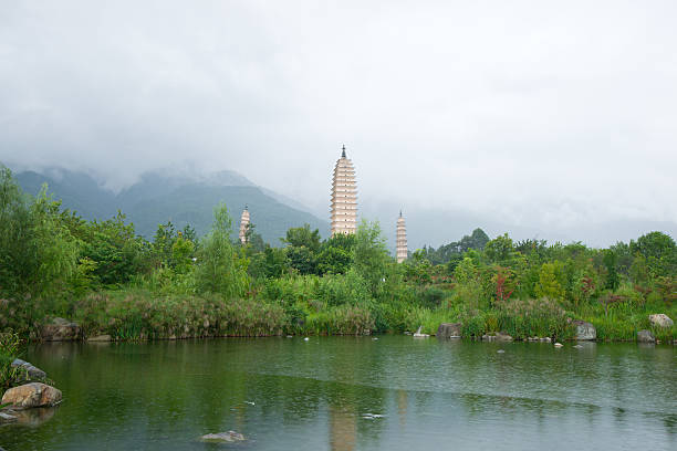 Three pagodas and water with reflection in Dali, China stock photo