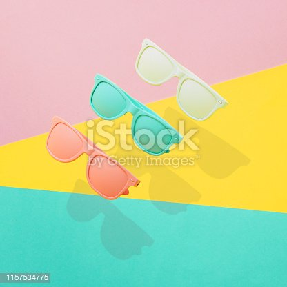 istock Three painted sunglasses fly in the air 1157534775
