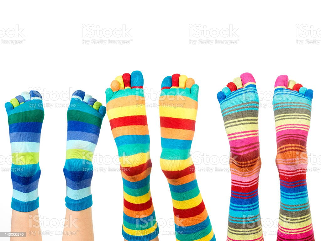 Three pairs of colorful striped socks with toes stock photo