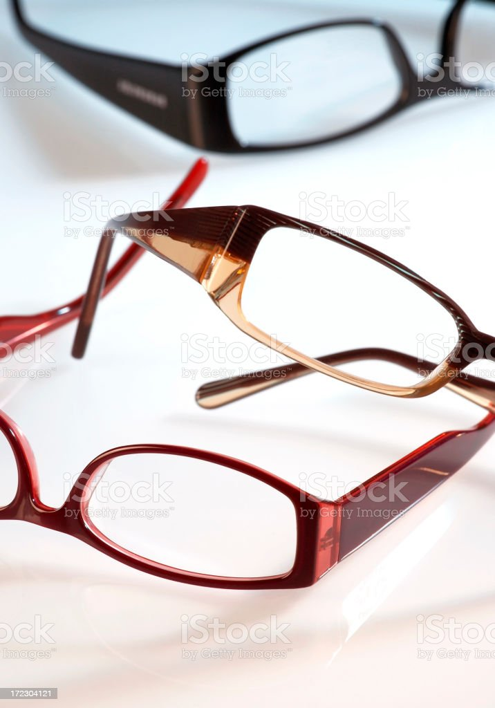 Three pairs of eye glasses with slightly rectangular frames royalty-free stock photo