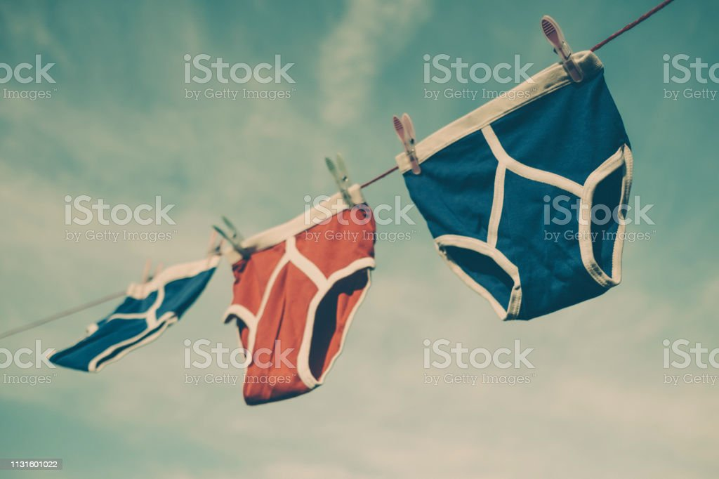 Three pairs of retro y-fronts on a washing line with a faded vintage film style. stock photo
