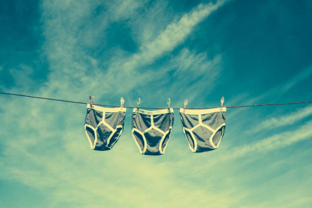 three pairs of retro y-fronts on a washing line with a faded vintage film style. - washing line stock photos and pictures