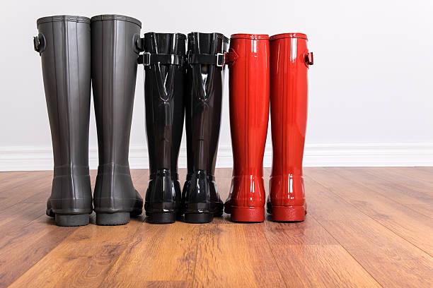 Three Pairs of Tall Rubber Boots - foto de acervo