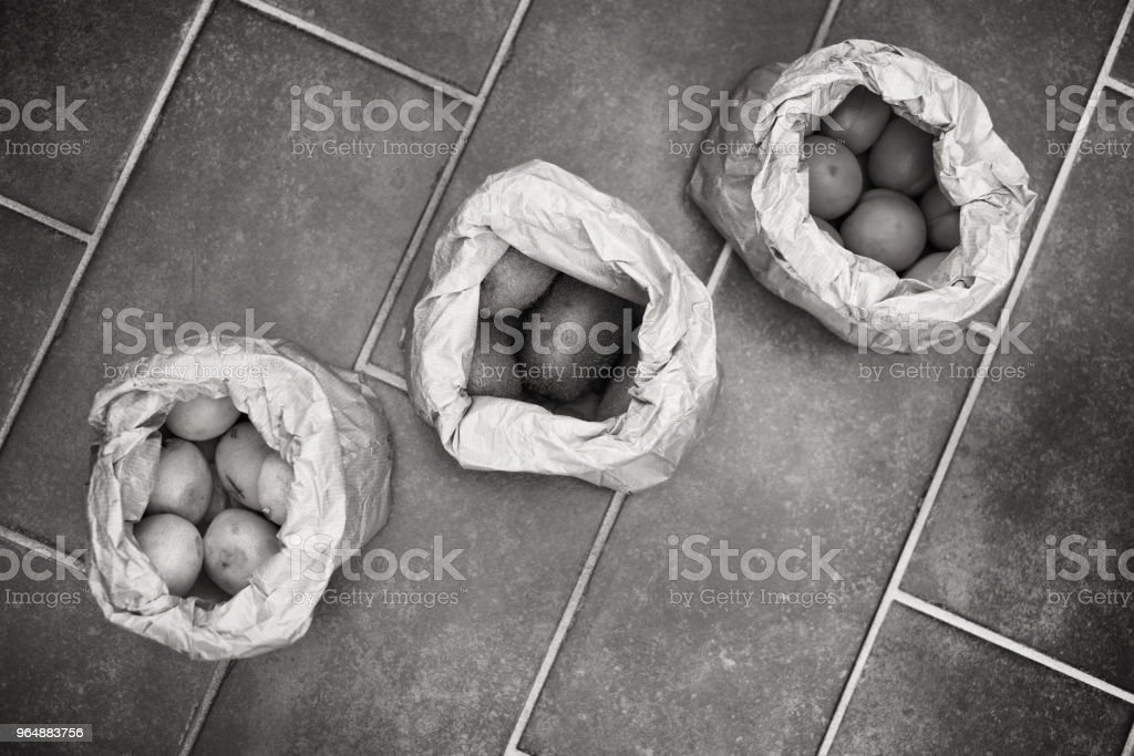Three paper bags of fresh fruits, black and white royalty-free stock photo