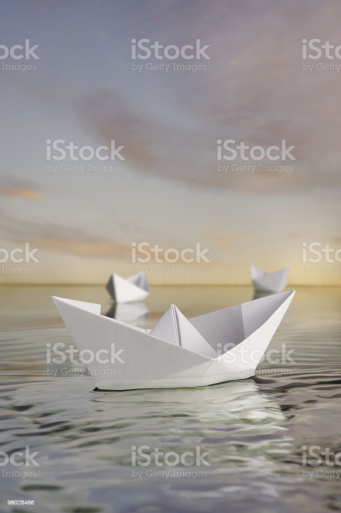 Three paper boats in calm water . royalty-free stock photo
