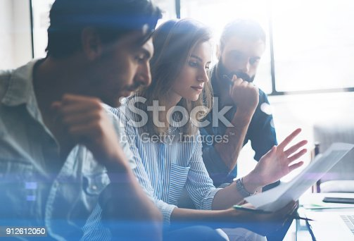 912617272 istock photo Three partners making research for new business direction.Business people meeting concept.Blurred background.Cropped. 912612050