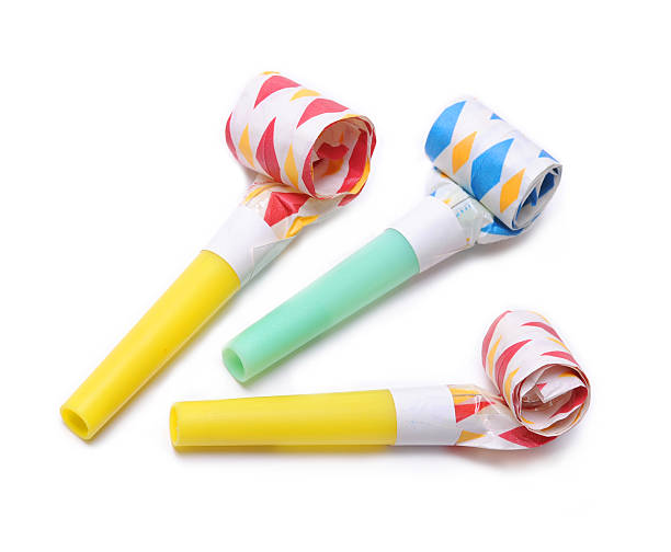 Three party Horn blowers on white background stock photo