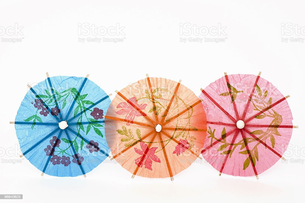 Three Party Umbrellas in Line stock photo
