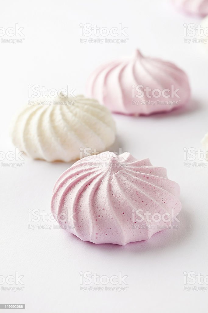 Three pastel colored meringue drops on a white background royalty-free stock photo