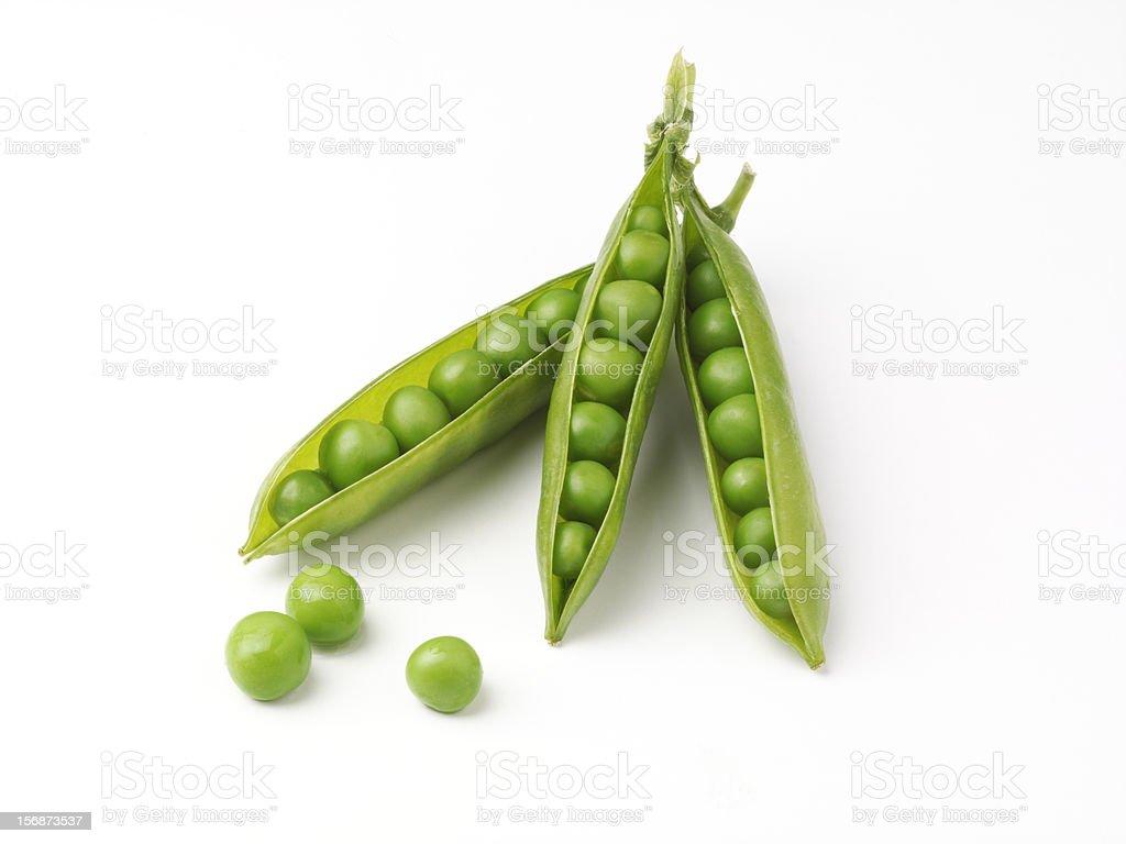 three pea pods with peas stock photo