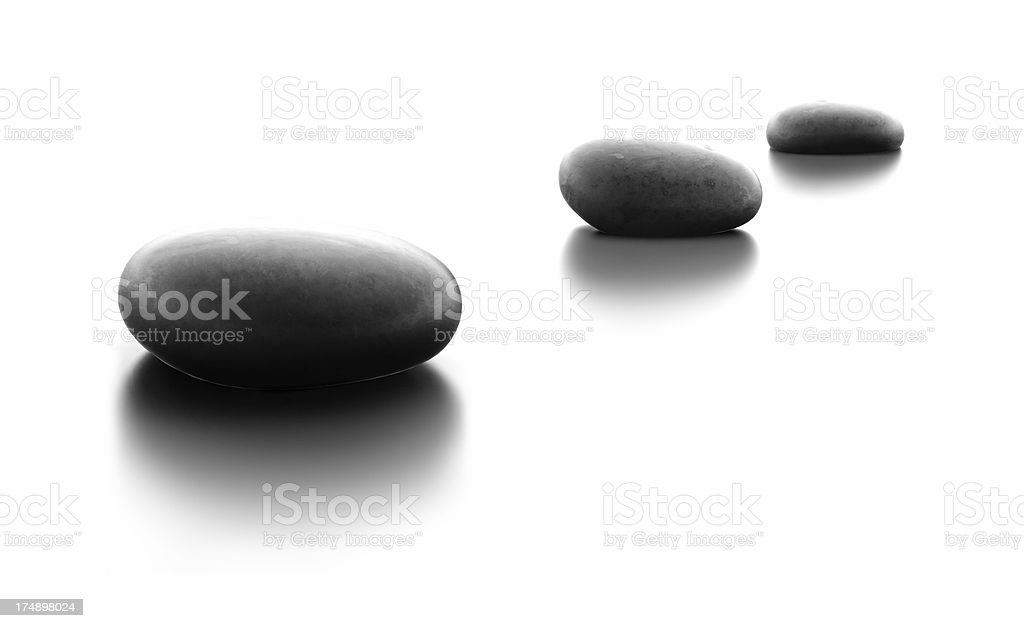 Three Pebble Stones in a Row stock photo