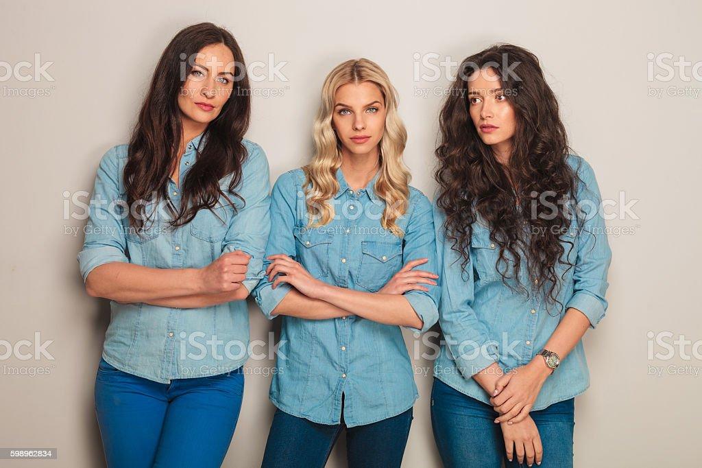 three pensive casual women standing stock photo