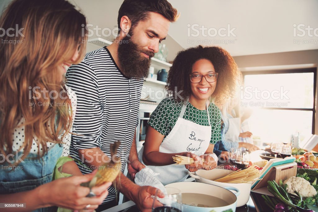 Three People Cooking At Kitchen Stock Photo Download Image Now Istock