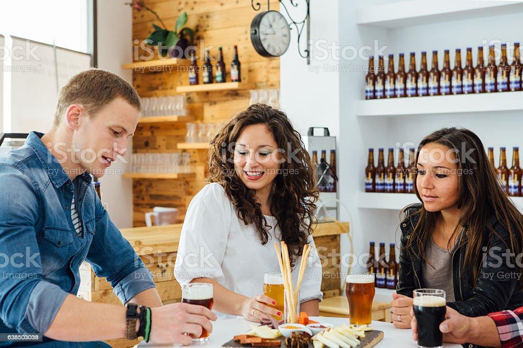 Three people degustating craft beer stock photo